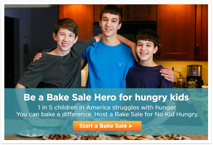 three boys in kitchen with baked goods - Be a Bake Sale Hero for hungry kids. 1 in 5 children in America struggles with hunger. You can bake a difference. Host a Bake Sale for No Kid Hungry - Start a Bake Sale button
